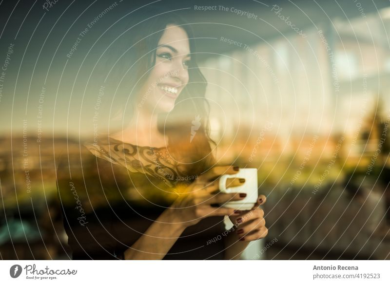 beautiful woman drinks a coffee while looking through the window of a bar young attractive 20s joy people person youth urban women pretty pretty people smile