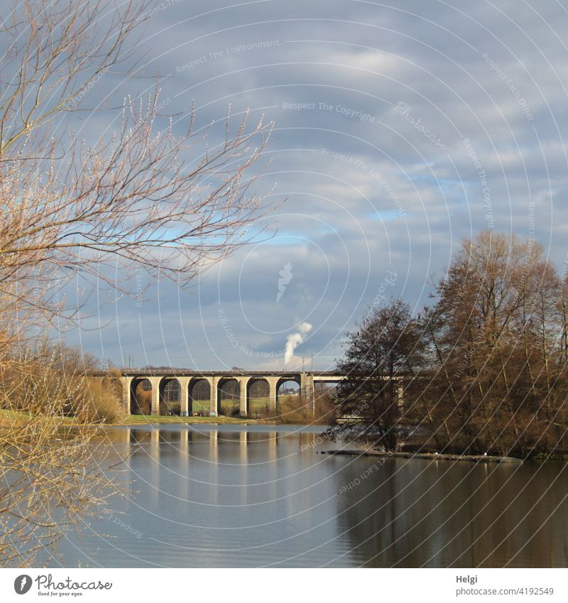 Viaduct at the lake with reflection, in the background high smoking chimneys viaduct Bridge Lake Lake Obersee Bielefeld Chimney Smoke Lakeside Tree shrub Sky