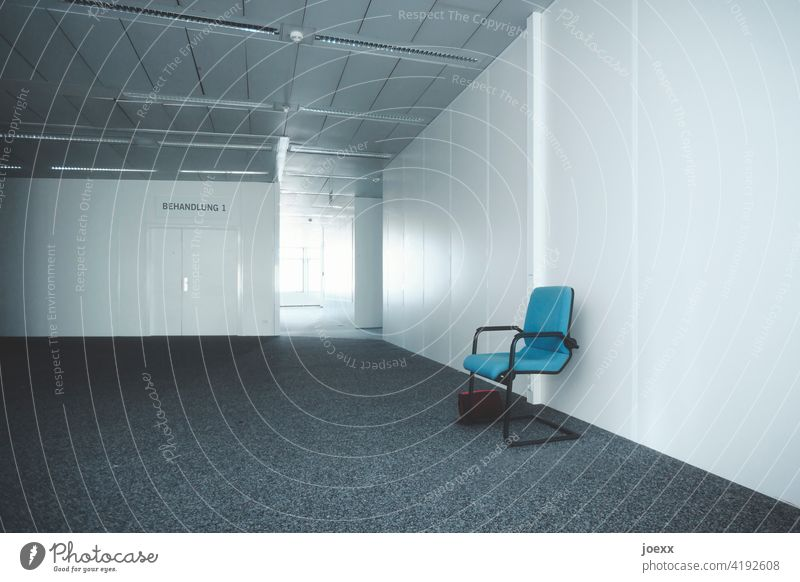 Cold anonymous waiting room in front of treatment room with blue chair and forgotten handbag Wait Waiting room Waiting room for doctors Chair Blue Gray Forget