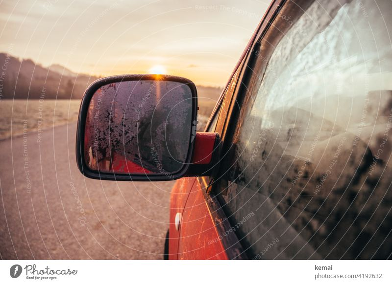 Frozen exterior mirror at sunrise car Orange exterior mirrors Cold Ice Back-light Light Slice Winter chill Ice crystal Hoar frost Mirror