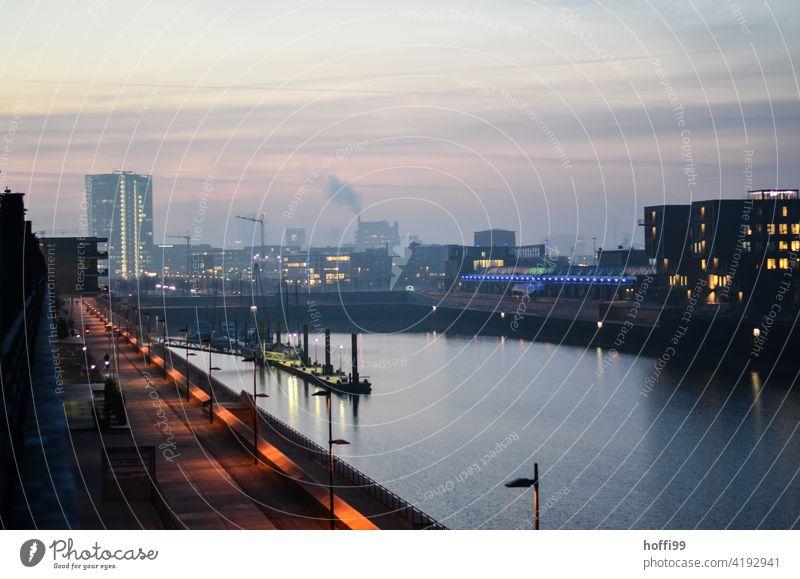 Sunrise over a harbour basin in the Überseestadt Bremen Berth harbour basins Weser Sunrise - Dawn Harbour Water River Jetty Navigation Bollard Sea promenade