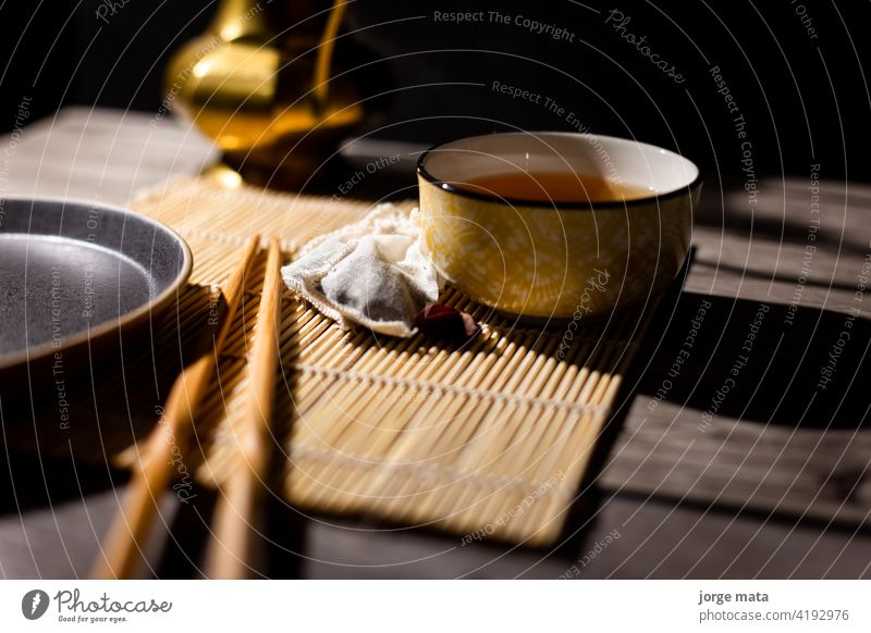 Dark tea background with cup of hot tea on the table. chinese tea china medicine tea - hot drink tea ceremony tea maker table top shot view ingredient organic
