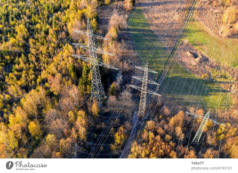 a high voltage road from above votlage ampere spring electricity pylon energy danger cable high voltage pylon power plant energy transportation