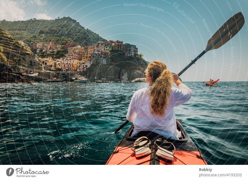By kayak towards Manarola from Cinque Terre Italy La Spezia vacation coast holidays Southern Europe Tourism Mediterranean sea coastal town tourist magnet