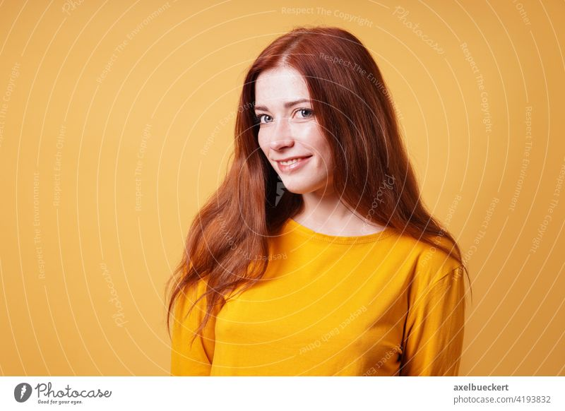 happy young woman with long red hair smiling adult person people pretty girl red-haired female beautiful attractive confidence confident portrait caucasian
