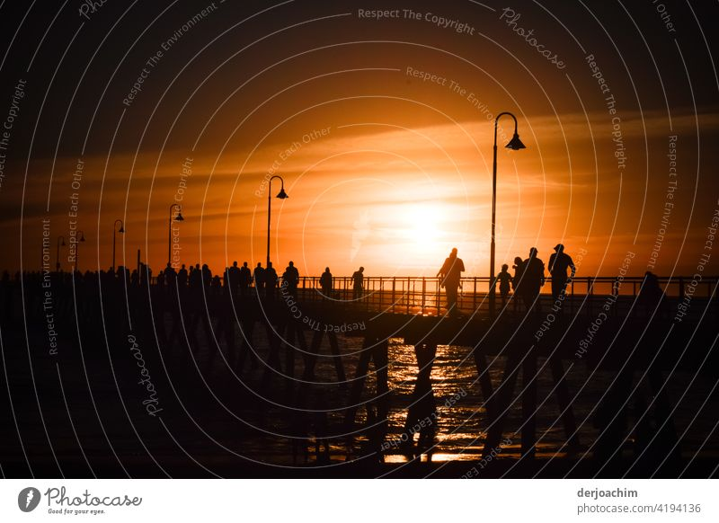 A special evening spectacle or spectacle, on the pier that takes place almost every evening. A few figures on the pier do not miss it. Sunset Ocean Evening