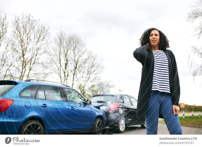 Female Driver With Whiplash Injury Standing By Damaged Car After Road Traffic Accident woman driver car accident wreck crash whiplash injury injured neck pain
