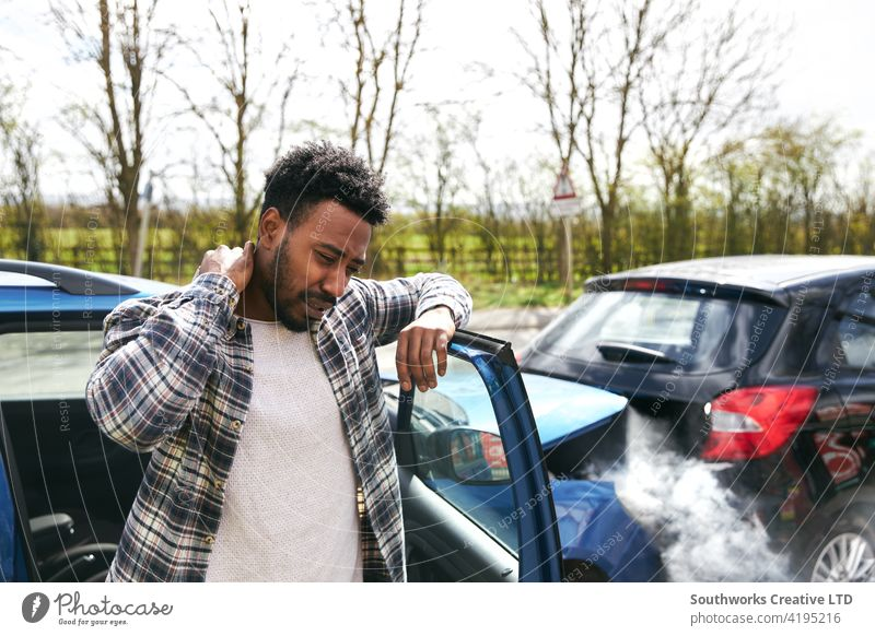 Uninsured Male Driver With Whiplash At Fault After Road Traffic Accident man driver car accident wreck crash whiplash injury injured neck pain uninsured fault