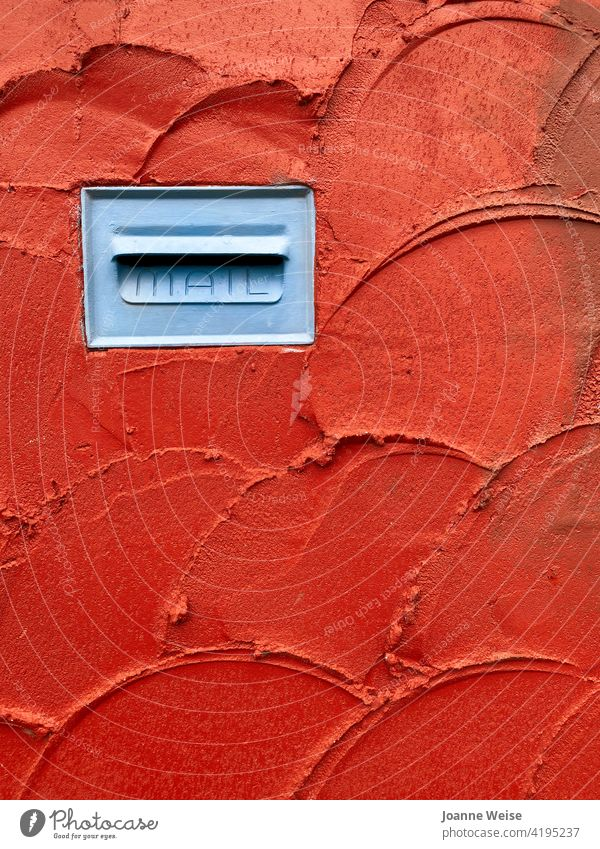 Blue mailbox in red stucco wall. Wall (barrier) Mailbox letterbox red wall Red Colour photo Exterior shot Letter (Mail) Fence Communicate Write