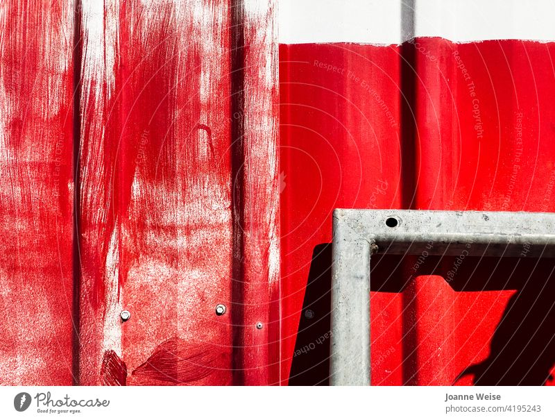 White wall with bright red paint and metal frame. Red Wall (building) Colour photo Exterior shot Day Building Bright Colours Metal Brush strokes sunny day