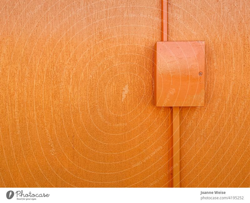 Orange wall with box. Colour photo Exterior shot Copy Space left Copy Space top Day Bright Colours orange wall Wall (building) Building Facade colourful