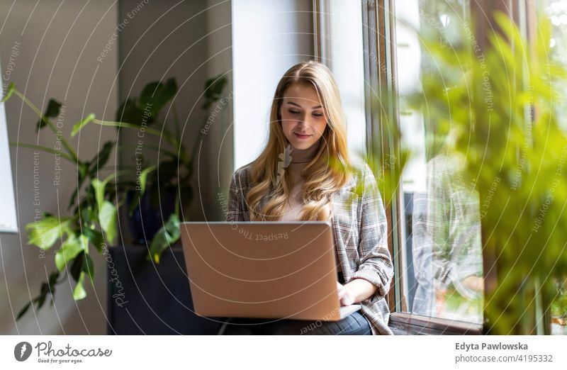 Young businesswoman using laptop in her office girl people Entrepreneur successful professional young adult female lifestyle indoors millennial attractive
