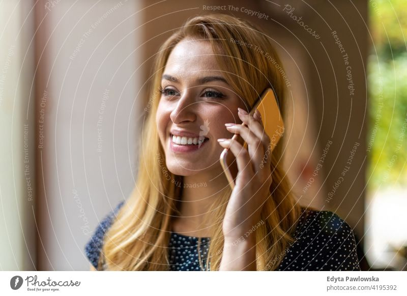 Young businesswoman using mobile phone in her office girl people Entrepreneur successful professional young adult female lifestyle indoors millennial attractive