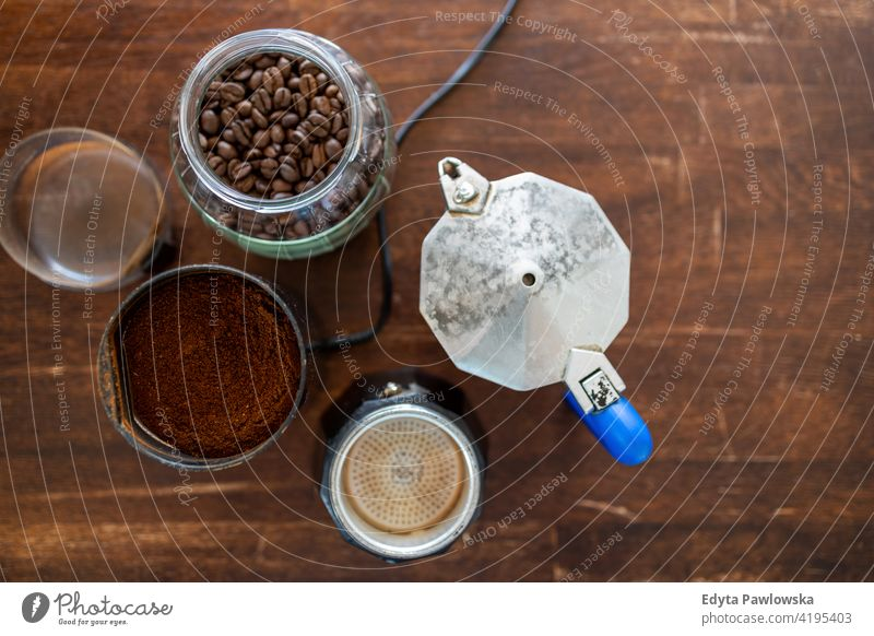 Above view of coffee supplies on wooden table preparation coffee percolator coffee maker hot roasted coffee crop cafe coffee beans cup of coffee coffee break