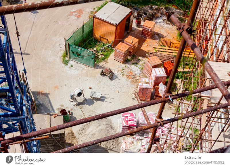 Above view on building site, scaffold, packed, piled resources Area Barrow Block Brick Brickwork Building Site Bundle Cart Cement Civil Engineering Complex