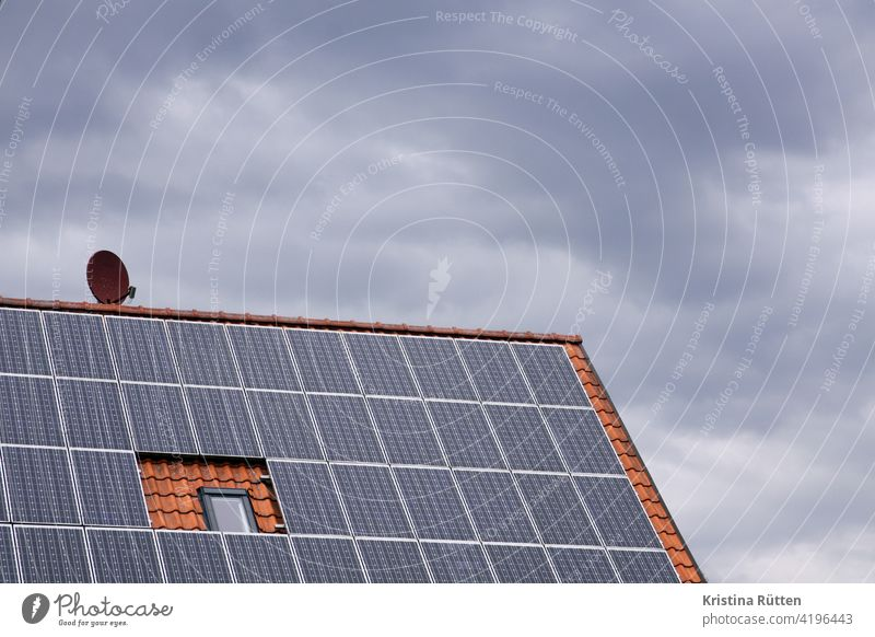 photovoltaic system, satellite dish, roof window that can no longer be opened and cloudy sky photovoltaics house roof system Roof House (Residential Structure)