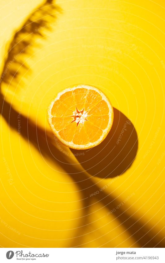 A slice of orange isolated on yellow background juicy food fruit fresh health close-up vitamin organic natural color image tropical healthy eating diet snack