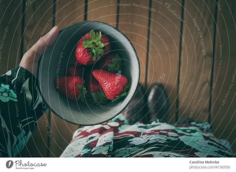 Woman holding a bowl of fresh crisp strawberries in her hand Strawberry shell Healthy Eating culinary arts Fruit Vitamin Breakfast Food Nutrition