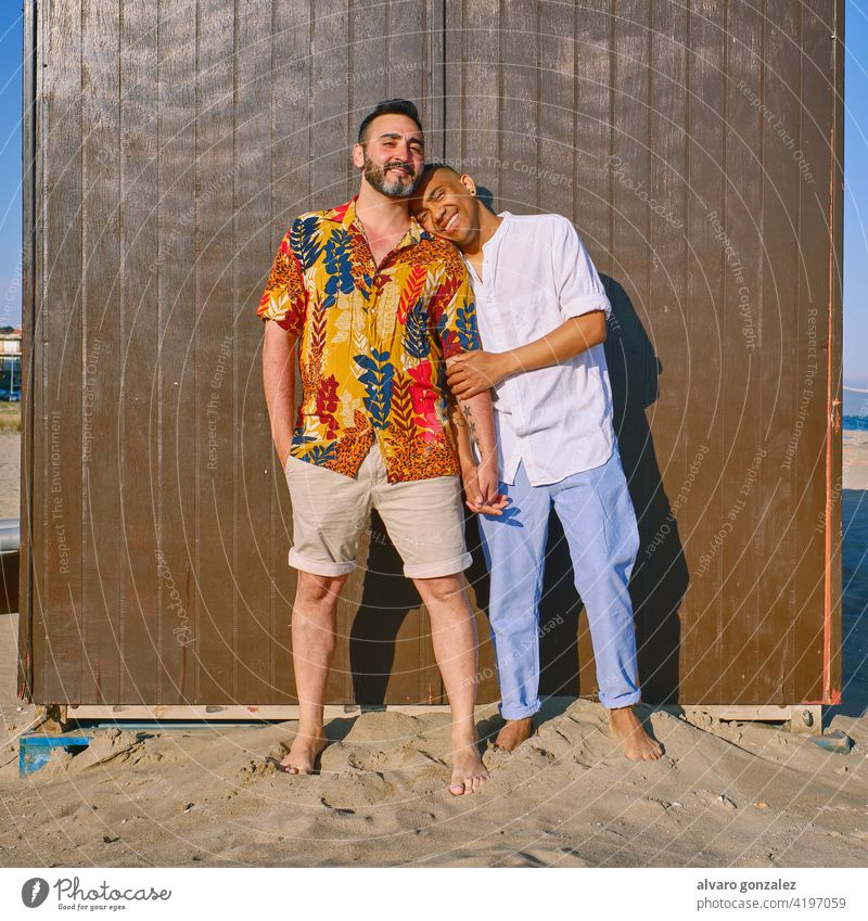 a gay couple at the beach in a sunny day love lgtb 25-29 Years Couple - Relationship Passion Leisure Activity Sharing African-American Ethnicity Happiness