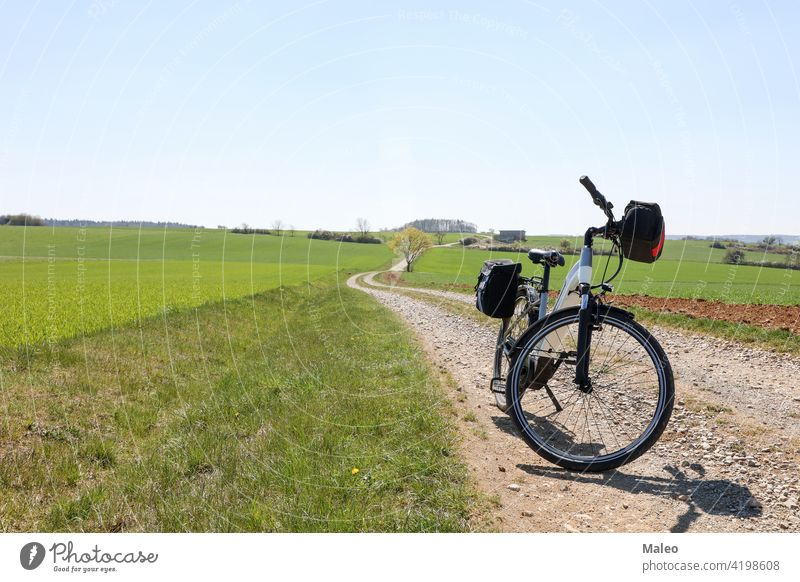 Spring landscape with an e-bike on the way bicycle electric biker evening leisure nature outdoor recreation sky sport spring summer adventure background beauty
