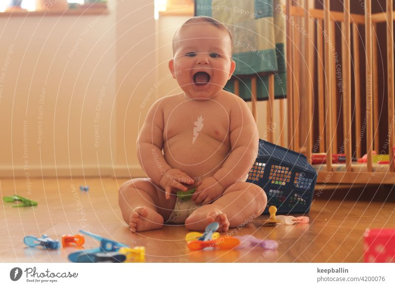 happy baby Baby Boy (child) Laughter cheerful Joy Happiness Infancy Toddler diaper Playing Sit fat baby Cute