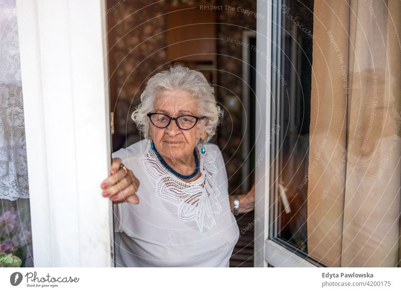Portrait of an elderly woman at her home eople senior mature casual female Caucasian house old aging domestic life grandmother pensioner grandparent retired