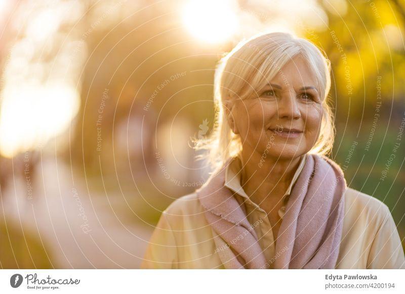 Senior woman outdoors senior people mature retired elderly old retiree pensioners one person retirement gray hair caucasian beautiful adult attractive enjoying