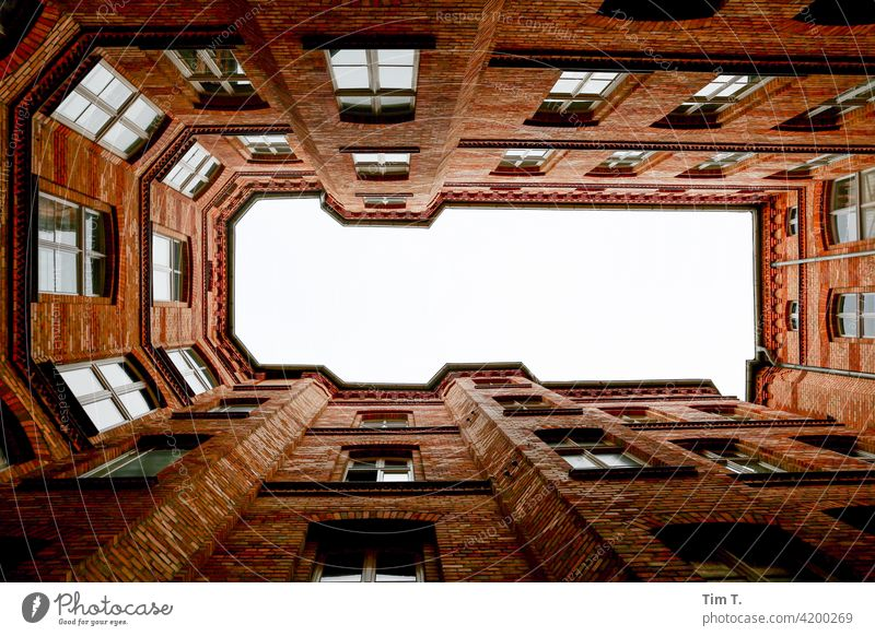 View upwards in a courtyard of the university Courtyard Upward Backyard old buildings Deserted Berlin Middle House (Residential Structure) Town Downtown Window