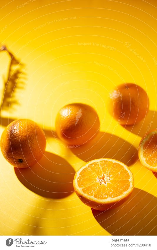 oranges in spring with yellow background food fruit freshness juicy vitamin pulp colours nourishment citric fruity refreshment tropical organic fruit stand