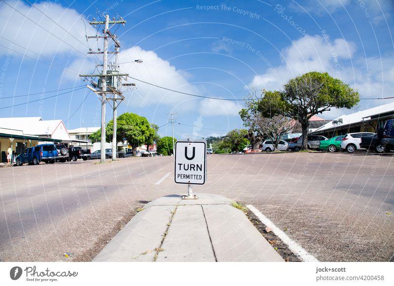 Douglas St. and the turnaround Turnaround allowed hairpin bend Street refuge Traffic infrastructure Lane markings Sunlight Calm Thursday Island Australia Word