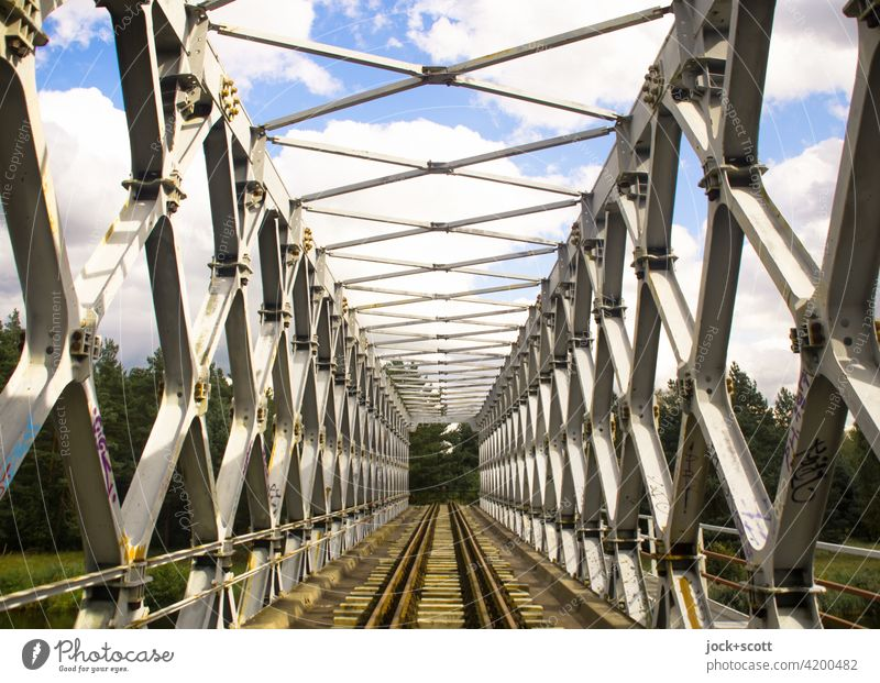 steel truss bridge in the sunlight Bridge Architecture Sky Clouds railway line Railroad tracks Railway bridge Traffic infrastructure lost places