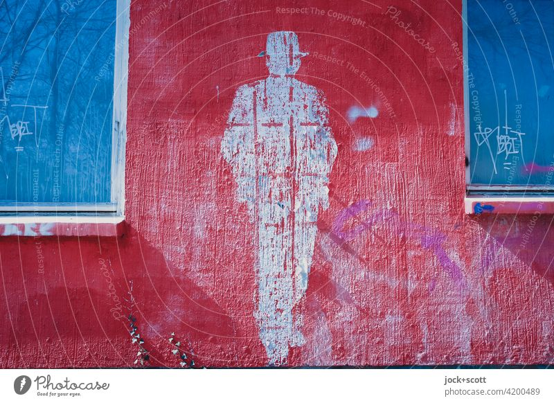 Figure of a person replaced by a plaster facade in color shape Posture Street art Subculture Style Lifestyle Silhouette Creativity Imprint Hat Wall (building)