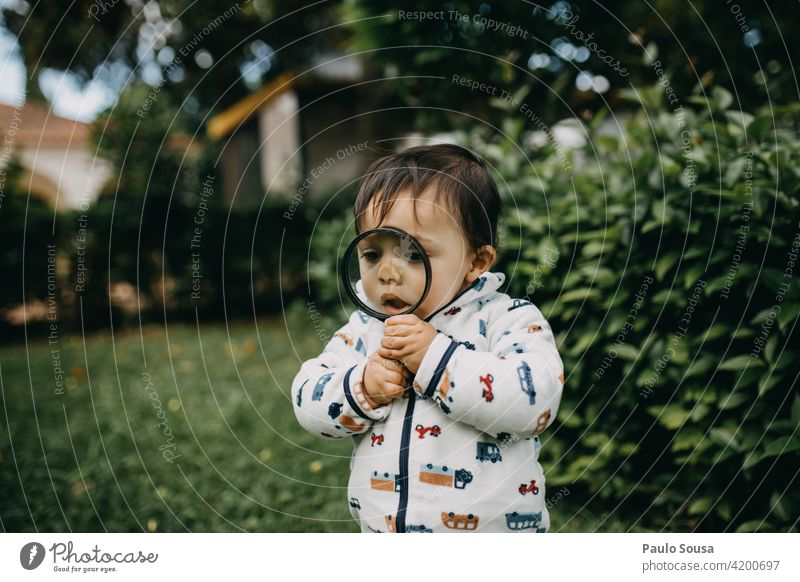 Child playing with magnifying glass childhood 1 - 3 years Caucasian Playing Magnifying glass Life Childhood memory Leisure and hobbies Lifestyle Toddler