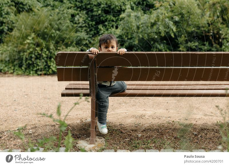 Child playing on garden bench 1 - 3 years Caucasian Bench Lifestyle Exterior shot Human being Colour photo Toddler Infancy Multicoloured Leisure and hobbies