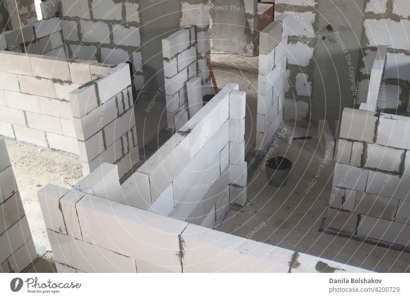 top view of walls under construction of foam blocks in walls of country house materials entrance reinforced contemporary housing perspective frame repair