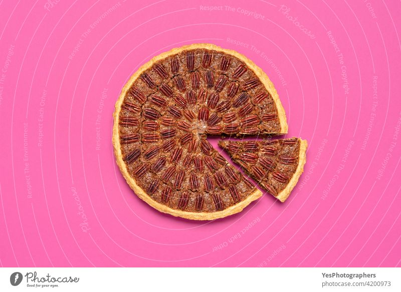 Pecan pie above view, isolated on a pink background. american autumn baked brown business cake chart christmas color copy space corn syrup crust cuisine cut out