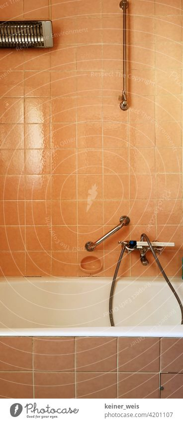 Old base room in orange with electric heater and faucet with shower head bathroom Orange Tile Bathroom Living or residing Bathtub Deserted Colour photo
