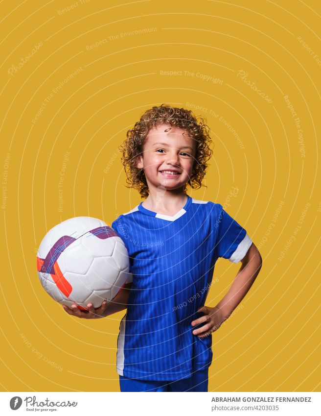 latino boy soccer player holds ball on isolated background sport football young child happy hispanic holding playing kid childhood game soccer ball education
