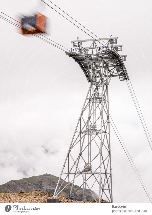 Cable car in motion, next to a large cable car mast. Stubai, Tyrol, Austria. Pole cabin gondola Track Cable car mast Alps Stubaital Innsbruck mountain Steel