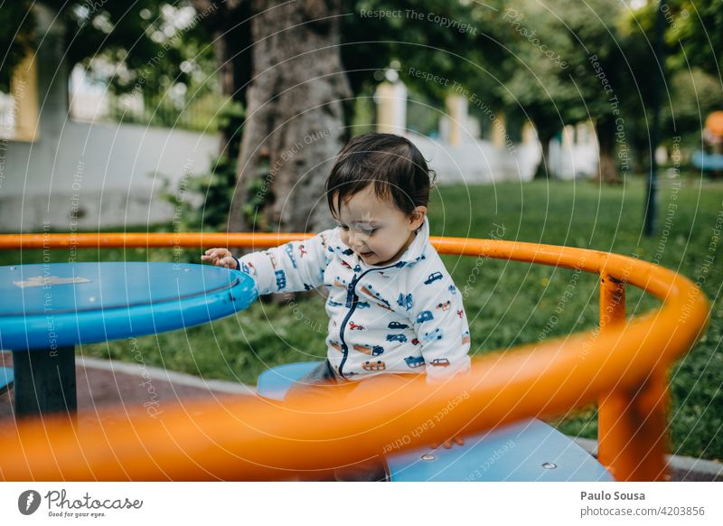 Child playing in the park 1 - 3 years Caucasian having fun Playground playground equipment Infancy Exterior shot Human being Colour photo Toddler