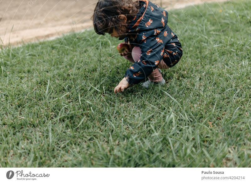 Child playing on the grass childhood Girl 1 - 3 years Caucasian Curiosity Innocent Authentic Happy Day Human being Lifestyle Infancy Nature Colour photo