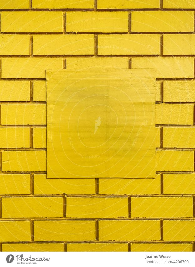 Yellow brick wall with central square blank space. yellow background Brick wall Wall (building) yellow wall Copy Space middle Colour photo Structures and shapes