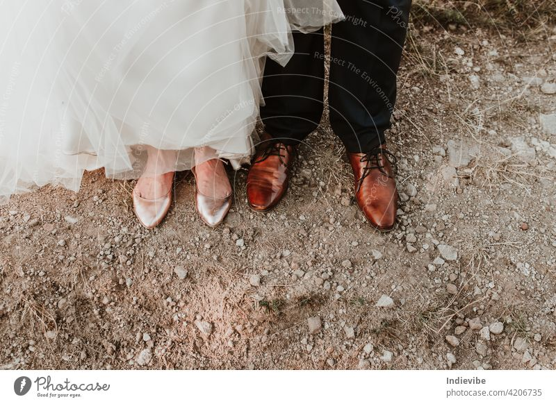 Bride and groom shoe detail on the ground on a wedding day. shoes bride big day feet beach sand foot legs summer woman nature people little soil small outdoors