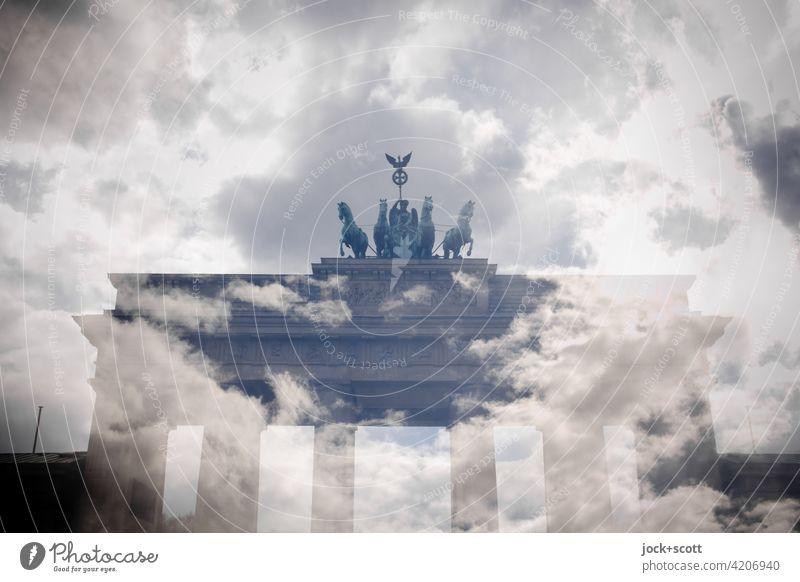 Clouds over Brandenburg Gate with commemorative colors Landmark Fantastic Experimental Double exposure Illusion Surrealism Reaction Pariser Platz Berlin Sky