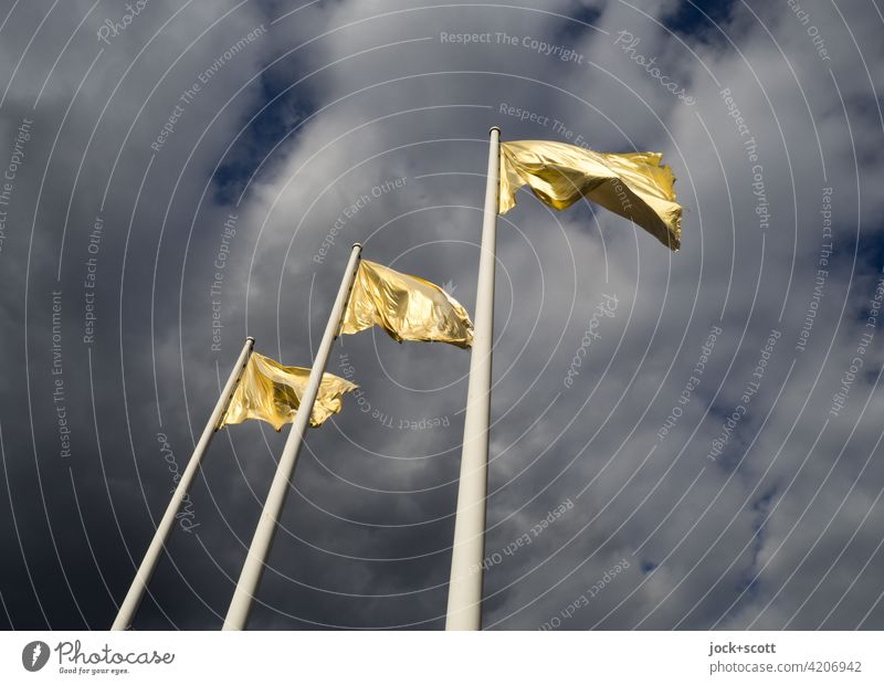 golden flag flutters in the wind Flagpole Sky Clouds Wind Blow Judder Gold Sunlight Street art three dark background Worm's-eye view