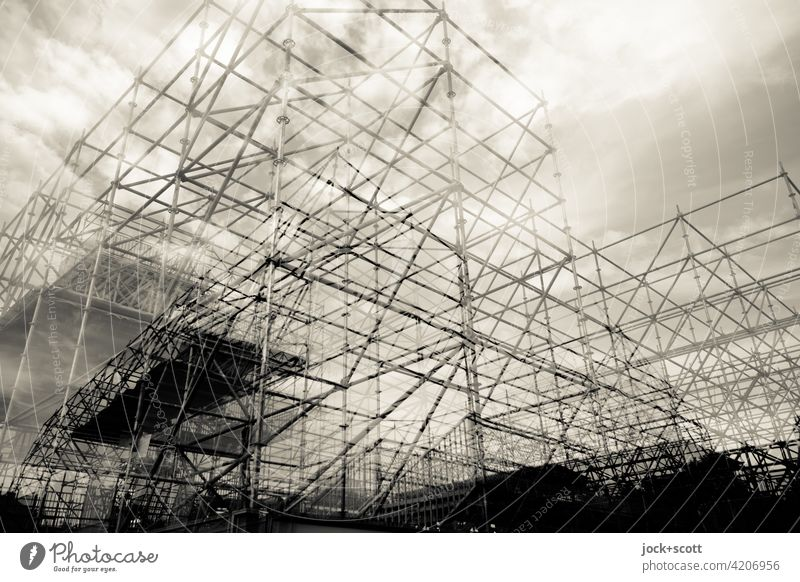 doubly well equipped Structures and shapes Scaffold Architecture Installations Construction Scaffolding Complex Double exposure Clouds in the sky