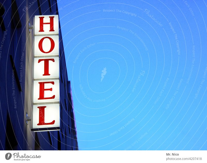 HOTEL Signage Hotel Vacation & Travel Tourism Characters Signs and labeling Blue sky Red Hostel Neon light Advertising Accommodation overnight Business trip