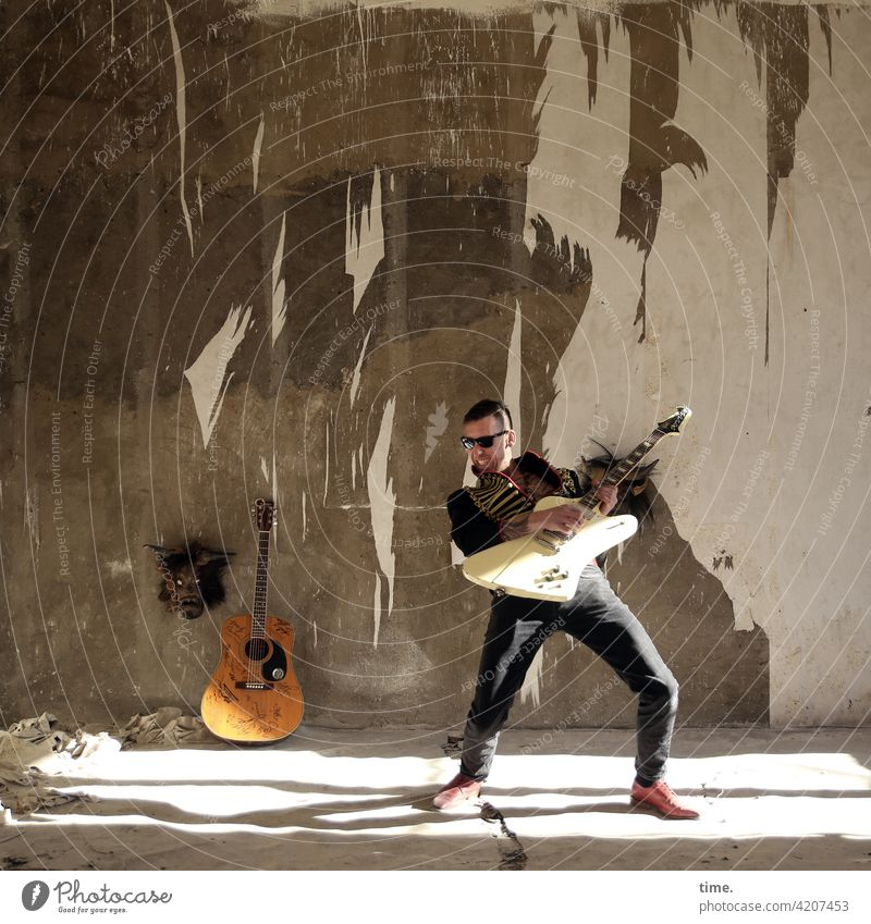 Stringmaster Full-length portrait Masculine Man Music Artist Guitar Musician Wall (barrier) Wall (building) Jacket Sunglasses lost places Ruin Stand Playing