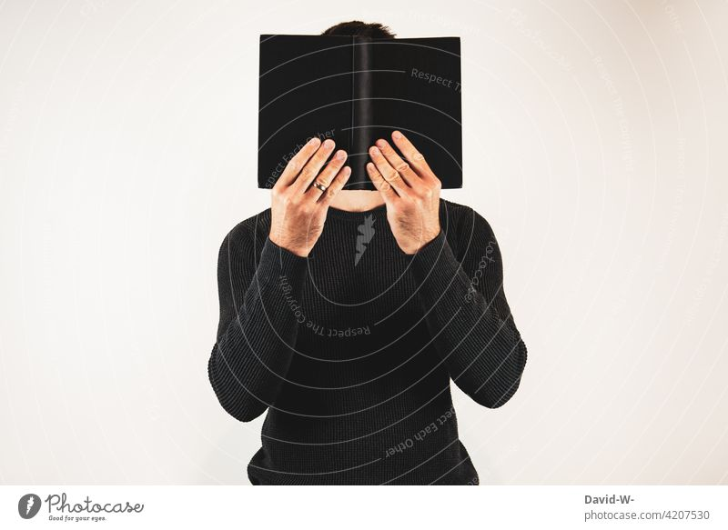 Man with book Book Reading educate further Hide Novel Reader Anonymous hollowed Reading matter Know