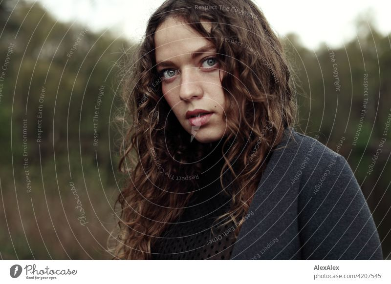 Portrait of a young woman with long, brunette, curly hair in front of a moor landscape Woman Young woman 18 - 30 years pretty Beauty & Beauty long hairs Curl